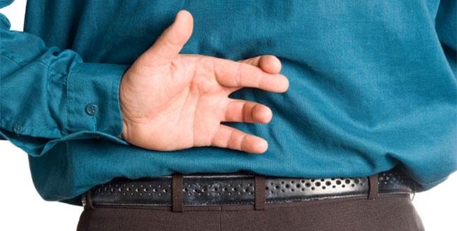 man-crossing-fingers-behind-back