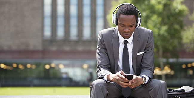 man listening to his phone