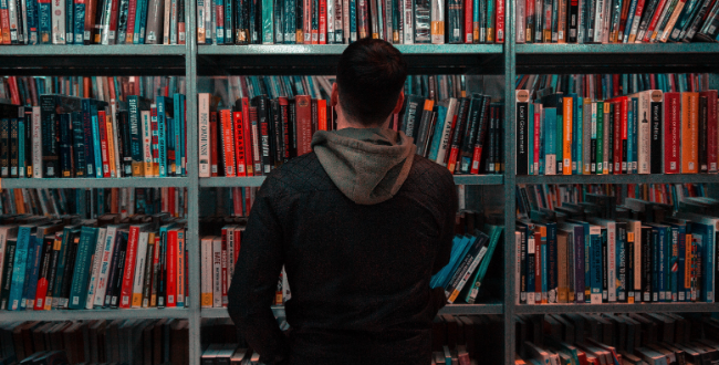 Man looking for library book